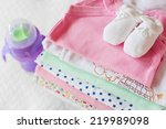 stack of baby clothing with a... | Shutterstock . vector #219989098