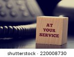 at your service written on a... | Shutterstock . vector #220008730