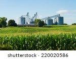 Cornfield With Silos And Farm...