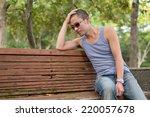 Men Sit On A Bench