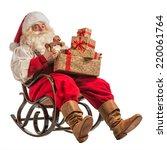 santa claus sitting in rocking... | Shutterstock . vector #220061764