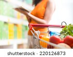 woman using tablet at store... | Shutterstock . vector #220126873