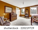 Stock photo brown bedroom with carved wood bed antique mirror and cabinet 220219729