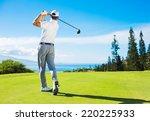 Golfer Hitting Ball With Club...