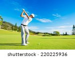 golfer hitting golf shot with... | Shutterstock . vector #220225936