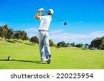 Golf Player Teeing Off. Man...