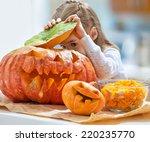 Little Girl Holding A Pumpkin