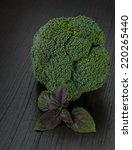 fresh broccoli on the desk | Shutterstock . vector #220265440