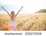 young woman in wheat field | Shutterstock . vector #220273558