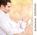 happy father with newborn... | Shutterstock . vector #220290163