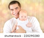 portrait of father with baby at ... | Shutterstock . vector #220290280