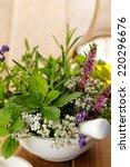 herbal bouquet in a mortar | Shutterstock . vector #220296676