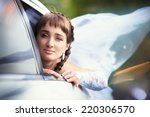 bride in the car | Shutterstock . vector #220306570