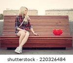 sad lonely girl sitting on a... | Shutterstock . vector #220326484
