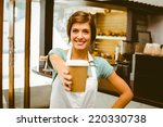 pretty barista smiling at... | Shutterstock . vector #220330738
