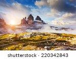 Great foggy view of the National Park Tre Cime di Lavaredo with rifugio Locatelli. Dolomites, South Tyrol. Location Auronzo, Italy, Europe. Dramatic cloudy sky. Beauty world. - stock photo