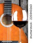 wine and guitar on a wooden... | Shutterstock . vector #220343263
