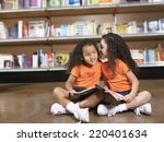 two young sisters whispering in ... | Shutterstock . vector #220401634