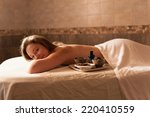 beautiful young woman in a spa... | Shutterstock . vector #220410559