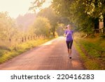 sporty woman running on a... | Shutterstock . vector #220416283