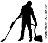 young man with vacuum cleaner ... | Shutterstock .eps vector #220485859