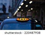 Closeup To A London Taxi Sign