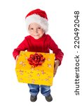 Little boy in christmas hat with yellow gift box, isolated on white - stock photo