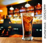 glass of cola with ice in a bar. | Shutterstock . vector #220522999