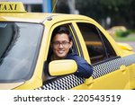 portrait of happy chinese taxi... | Shutterstock . vector #220543519