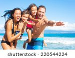 happy mixed race family of four ... | Shutterstock . vector #220544224