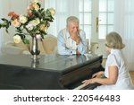 Senior Woman Playing The Piano...