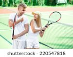 young couple playing tennis | Shutterstock . vector #220547818