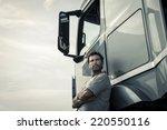 portrait of a truck driver | Shutterstock . vector #220550116