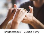young couple holding hands in... | Shutterstock . vector #220554199