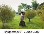 woman in a brown hat with brim... | Shutterstock . vector #220562689