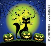 cat and halloween pumpkins... | Shutterstock .eps vector #220568389