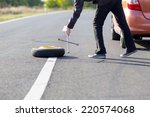 spare wheel of a car with tool | Shutterstock . vector #220574068