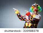 funny clown in colourful costume | Shutterstock . vector #220588378
