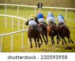 Stock photo jockeys on horses at the track 220593958