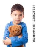 cute boy in pajamas hugging a... | Shutterstock . vector #220625884
