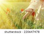 Woman Walking In A Field Of...