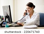businesswoman talking by phone | Shutterstock . vector #220671760