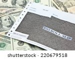 payroll slip on pile of us... | Shutterstock . vector #220679518