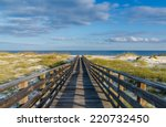 a wooden walkway to the gulf of ... | Shutterstock . vector #220732450