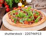 ham pizza with rocket  fresh... | Shutterstock . vector #220746913