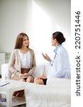 female patient listening to... | Shutterstock . vector #220751446