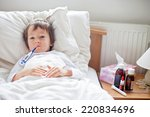 sick child boy lying in bed... | Shutterstock . vector #220834696