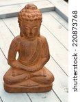 Small photo of Buddha stature sitting on old wood