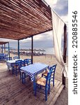 greek tavern on beach | Shutterstock . vector #220885546