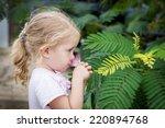 Cute Little Girl Smelling A...